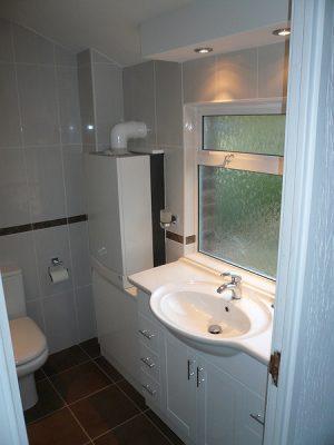 Mise en place du chauffe eau dans la salle de bain